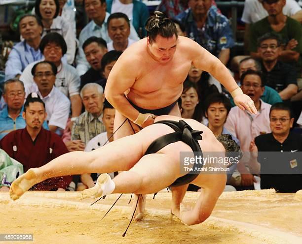 Yokozuna Kakuryu throws Ikioi to win during day one of the Grand Sumo Nagoya Tournament at Aichi Prefecture Gymnasium on July 13 2014 in Nagoya Aichi...