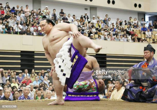 Yokozuna Kisenosato performs a ringentering ceremony in Hitachi Ibaraki Prefecture on Aug 10 2017 as he joins joins the sumo's summer regional tour...