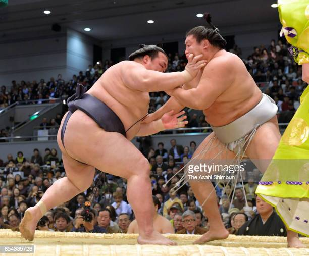 Yokozuna Kisenosato pushes Mongolian Takanoiwa out of the ring to win during day three of the Grand Sumo Spring Tournament at Edion Arena Osaka on...