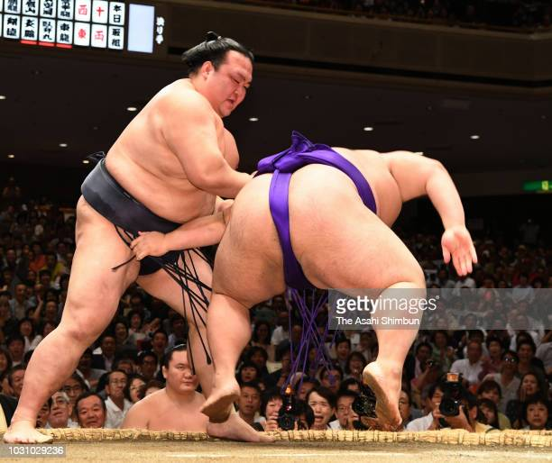 Yokozuna Kisenosato throws komusubi Takakeisho to win on day two of the Grand Sumo Autumn Tournament at Ryogoku Kokugikan on September 10 2018 in...