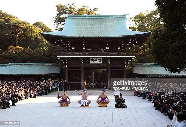 Yokozuna or grand champion of sumo Hakuho performs the ceremonial entrance into the ring with Tachimochi or swordbearer Aminishiki Tsuyuharai or...