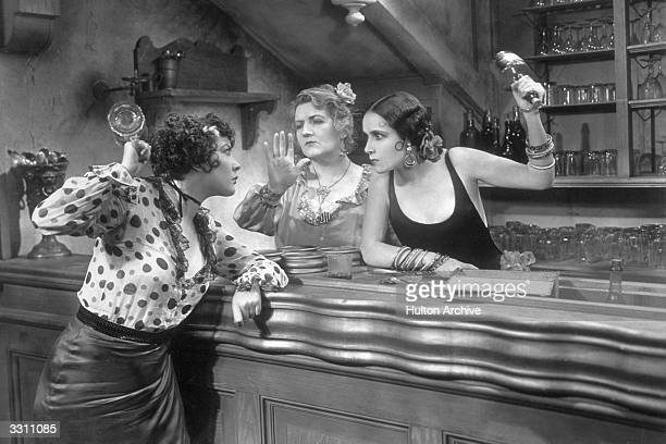 Yola d'Avril, Adrienne d'Ambricourt and Dolores Del Rio during a tense situation in a still from the musical 'The Bad One', directed by George...