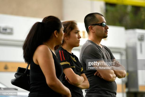 Yolanda De Santiago left her daughter Maria 17 and her husband Eli Mendoza watch as firefighters search their apartment for their 6 animals at the...