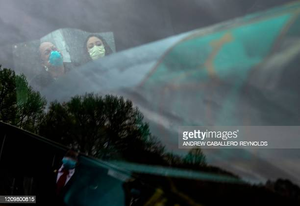 Yolanda Flowers cries as the casket of her father the pastor of the Shining Star Freewill Baptist church Bishop James N Flowers Jr is seen inside a...