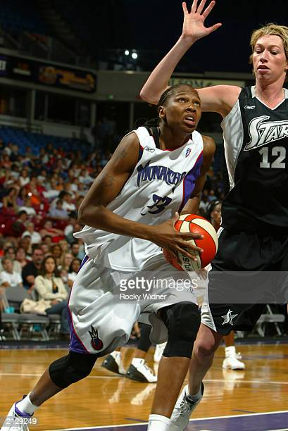Yolanda Griffith of the Sacramento Monarchs drives against Margo Dydek of the San Antonio Silver Stars during the game at Arco Arena on June 24 2003...