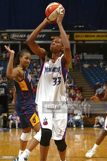 Yolanda Griffith of the Sacramento Monarchs shoots the ball against Tamika Catchings of the Indiana Fever during their game on June 14 2003 at Arco...