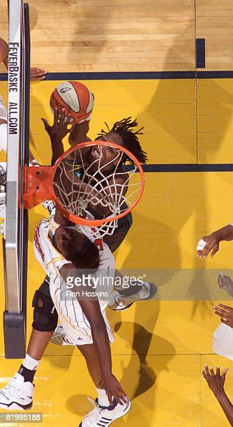 Yolanda Griffith of the Seattle Storm shoots over Ebony Hoffman of the Indiana Fever at Conseco Fieldhouse on July 18 2008 in Indianapolis Indiana...