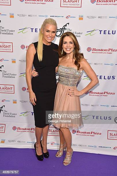 Yolanda Hadid and Christi Paul attends the David Foster Foundation Benefit Concert at Allstream Centre on December 5, 2013 in Toronto, Canada.