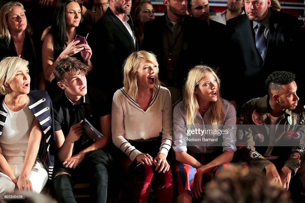 Yolanda Hadid, Anwar Hadid, Taylor Swift, Martha Hunt, and Lewis Hamilton attend the #TOMMYNOW Women's Fashion Show during New York Fashion Week at Pier 16 on September 9, 2016 in New York City.