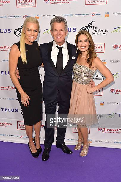 Yolanda Hadid, producer/composer David Foster and Christi Paul attends the David Foster Foundation Benefit Concert at Allstream Centre on December 5,...