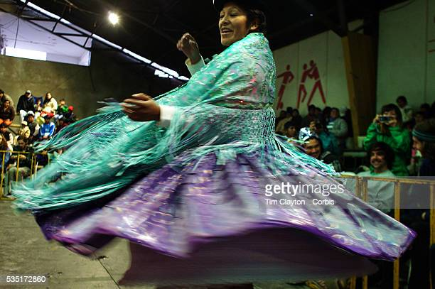 Yolanda La Amorosa dances for the audience as she is introduced before her bout during the 'Titans of the Ring' wrestling group's Sunday performance...