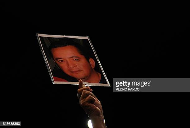 Yolanda Moran holds a picture of her missing son Dan Jeremeel Fernandez who disappeared on December 19 2008 in Torreon Coahuila as she attends the...