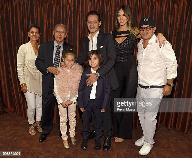 Yolanda Muniz Felipe Muniz Emme Muniz Marc Anthony Max Muniz Shannon De Lima and Bigram Zayas pose backstage at Radio City Music Hall on August 27...