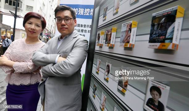 Yolanda Ng Yuenting Vicechairman and Antonio Kwong Choshing Chairman of the Hong Kong Council on Smoking and Health demonstrate the impact of...