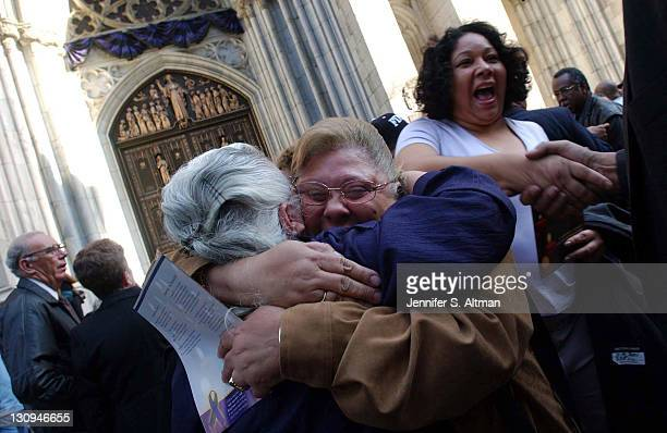 Yolanda Ruiz hugs her coworker Trinidad Domeneca from the World Trade Center after a memorial service for Local 32BJ SEIU at St Patrick's Cathedral...