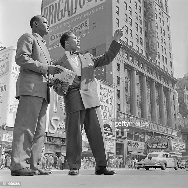 Yolande Pompee , British middleweight and light heavyweight from Trinidad, points out a Times Square highlight to his fellow countryman, Hector...