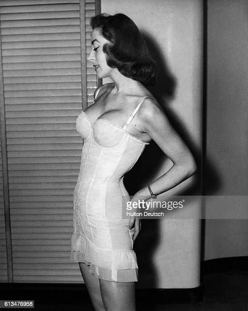 Yolande Roy models a nylon corset entitled Sheherazade by Kestos at a French corset industry show held in London's Savoy Hotel February 1955