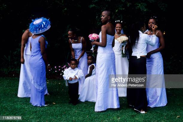 Yolissa Koza a consultant for an international management consulting company walks with her sister and brides maids just after she got married on...
