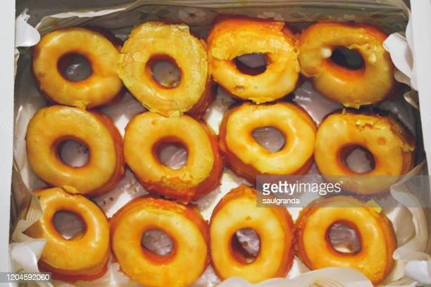 yolk donuts (rosquillas de alcalá) in a box - alcala de henares stock pictures, royalty-free photos & images