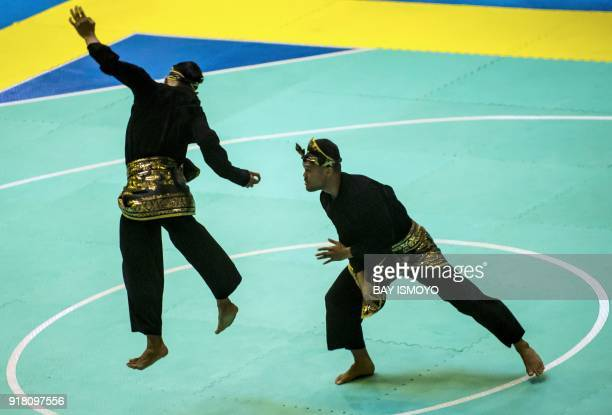 Yolla Primadona Jampil and Hendy of Indonesia perform during men's double final of Asian Games 2018 test event in Jakarta on February 14 2018 / AFP...