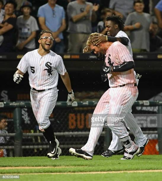 Yolmer Sanchez Matt Davidson and Alen Hanson of the Chicago White Sox celebrate after Davidson got the gamewinning hit in the 9th inning against the...