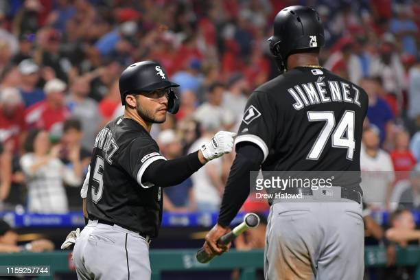 Yolmer Sanchez of the Chicago White Sox congratulates teammate Eloy Jimenez after scoring the game tying tun in the ninth inning against the...