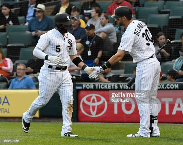 Yolmer Sanchez of the Chicago White Sox is greeted by Nicky Delmonico after scoring against the Pittsburgh Pirates during the first inning on May 8...