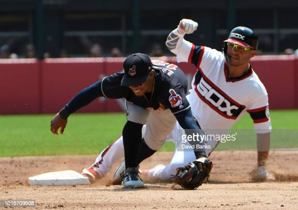 Yolmer Sanchez of the Chicago White Sox is safe at second base as Francisco Lindor of the Cleveland Indians takes the throw during the first inning...