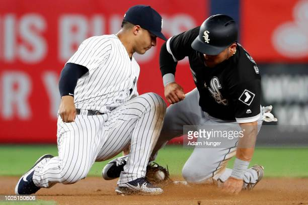 Yolmer Sanchez of the Chicago White Sox is tagged out attempting to steal second base by Gleyber Torres of the New York Yankees during the seventh...