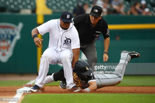 Yolmer Sanchez of the Chicago White Sox is tagged out trying to steal third base in the first inning by Jeimer Candelario of the Detroit Tigers at...