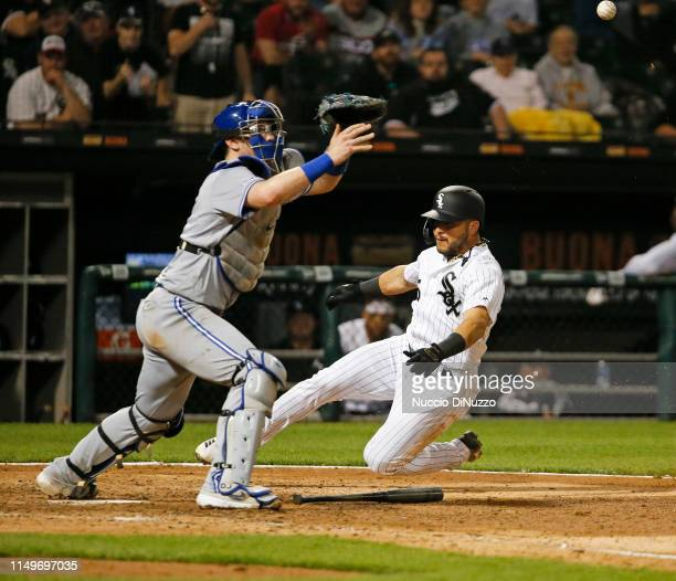 Yolmer Sanchez of the Chicago White Sox scores ahead of the throw to Danny Jansen of the Toronto Blue Jays during the eighth inning at Guaranteed...