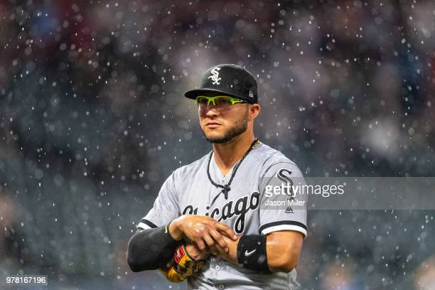 Yolmer Sanchez of the Chicago White Sox walks off the field after umpires called a delay of game due to weather during the seventh inning against the...