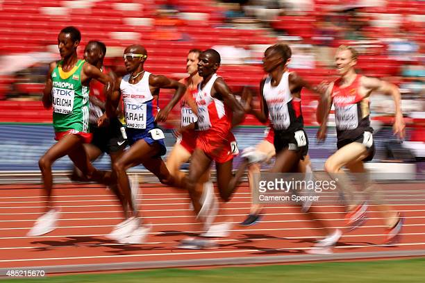 Yomif Kejelcha of Ethiopia and Mohamed Farah of Great Britain competes in the Men's 5000 metres heats during day five of the 15th IAAF World...