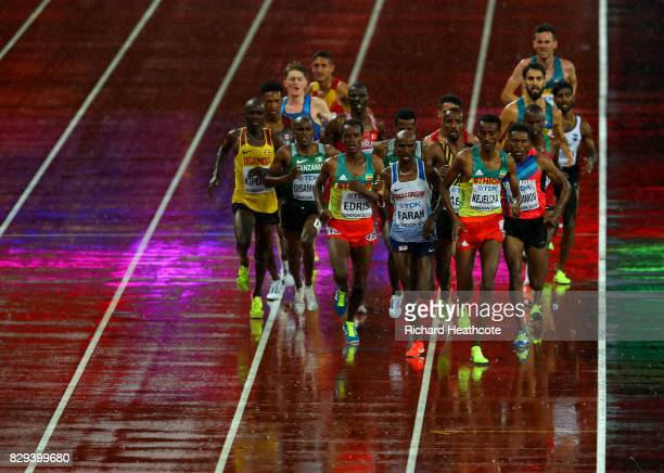 Yomif Kejelcha of Ethiopia leads heat one of the Men's 5000 Metres heats ahead of Mohamed Farah of Great Britain and Muktar Edris during day six of...