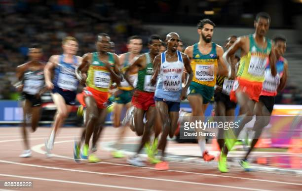Yomif Kejelcha of Ethiopia Mohamed Farah of Great Britain and Muktar Edris of Ethiopia compete in the Men's 5000 Metres heats during day six of the...