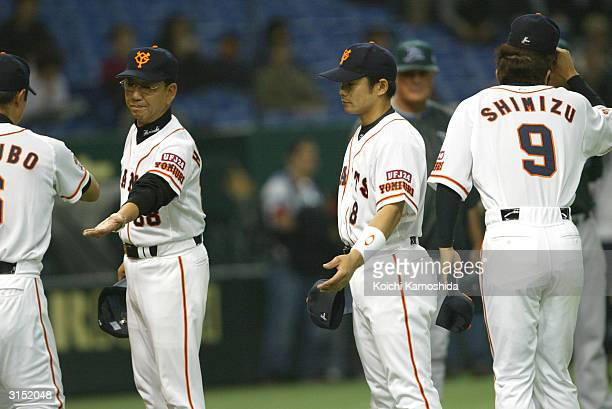 Yomiuri Giants manager Tsuneo Horiuchi welcomes his players in the beginning of an exhibition game between the Tampa Bay Devil Rays vs the Yomiuri...