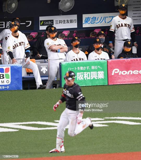 Yomiuri Giants players react after Ryoya Kurihara of the Fukuoka SoftBank Hawks hits a two-run double in the 6th inning during the game one of the...