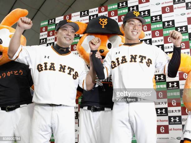 Yomiuri Giants' Shinnosuke Abe and Shingo Usami pose for photos as they contributed to the team's 63 win over the Hanshin Tigers on Aug 25 at Tokyo...