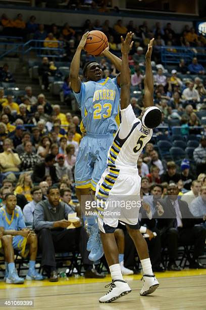 Yondarius Johnson of the Southern Jaguars pulls up for a three pointer during the game against the Marquette Golden Eagles at BMO Harris Bradley...