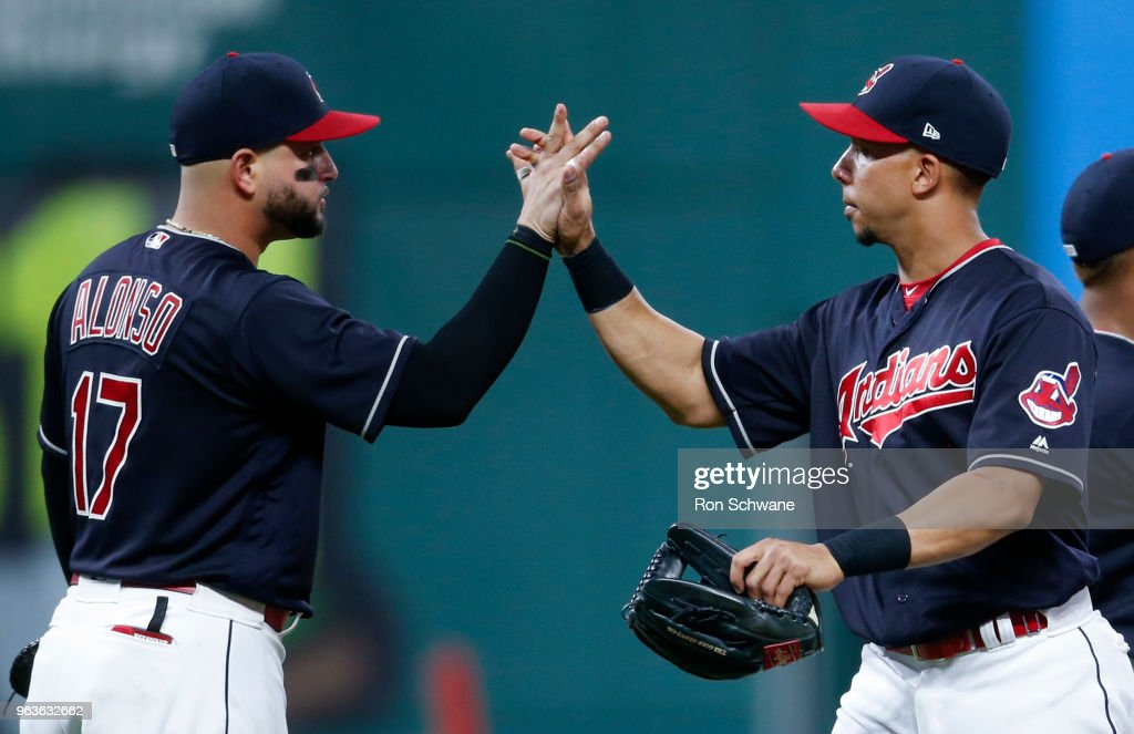 Yonder Alonso #17 and Michael Brantley #23 of the Cleveland Indians celebrate a 7-3 victory over the Chicago White Sox at Progressive Field on May 29, 2018 in Cleveland, Ohio.