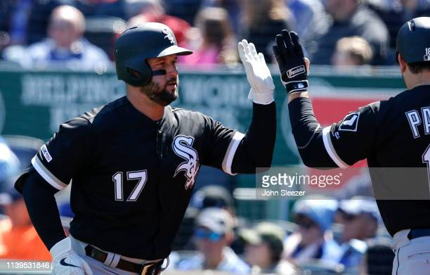 Yonder Alonso of the Chicago White Sox is congratulated after hitting a solo home run in the fourth inning during the game against the Kansas City...