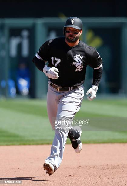 Yonder Alonso of the Chicago White Sox rounds the bases on a solo home run off starting pitcher Jorge Lopez of the Kansas City Royals in the fourth...