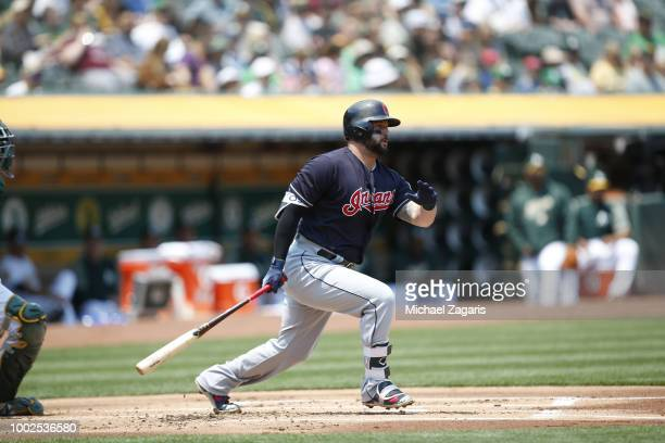 Yonder Alonso of the Cleveland Indians bats during the game against the Oakland Athletics at the Oakland Alameda Coliseum on July 1 2018 in Oakland...