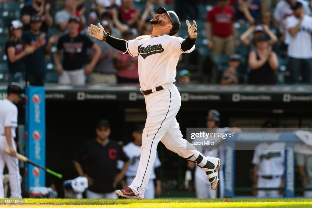 Yonder Alonso #17 of the Cleveland Indians celebrates after hitting a solo home run to tie the game in the 13th inning against the Houston Astros at Progressive Field on May 27, 2018 in Cleveland, Ohio.