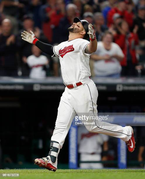 Yonder Alonso of the Cleveland Indians celebrates as he rounds the bases after hitting a grand slam home run off of Johnny Barbato of the Detroit...