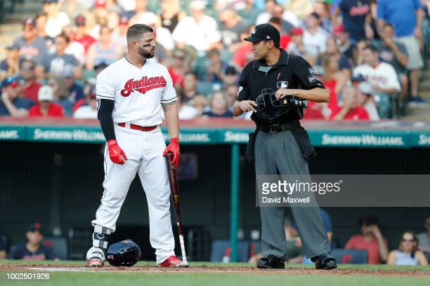 Yonder Alonso of the Cleveland Indians exchanges words with home plate umpier Gabe Morales after striking out against the New York Yankees during the...