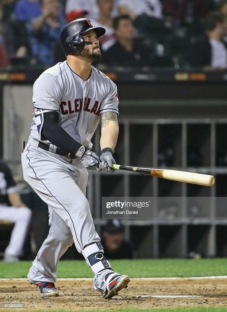 Yonder Alonso #17 of the Cleveland Indians follows the flight of his off the wall double in the 7th inning against the Chicago White Sox at Guaranteed Rate Field on June 12, 2018 in Chicago, Illinois.
