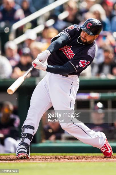 Yonder Alonso of the Cleveland Indians hits a home run in the second inning against the Cincinnati Reds during a Spring Training Game at Goodyear...