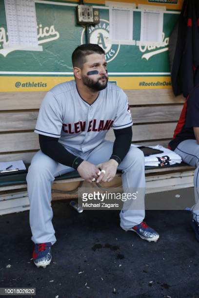 Yonder Alonso of the Cleveland Indians sits in the dugout prior to the game against the Oakland Athletics at the Oakland Alameda Coliseum on June 29...
