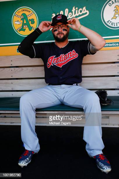 Yonder Alonso of the Cleveland Indians sits in the dugout prior to the game against the Oakland Athletics at the Oakland Alameda Coliseum on June 30...